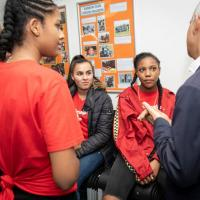 The Mayor speaks with young women at the Harrow Club