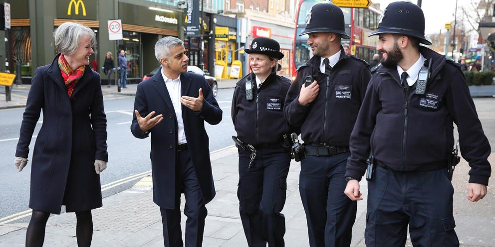 Mayor Sadiq Khan walks with Deputy Mayor Sophie Linden and police constables