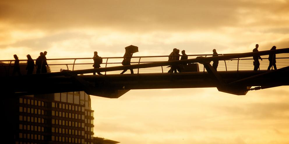 Man with umbrella on Jubilee Bridge
