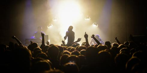 Silhouette of band on stage