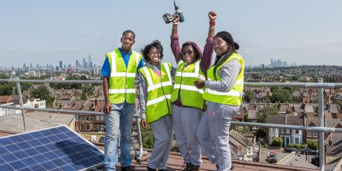 Group of young people on a roof with solar panel