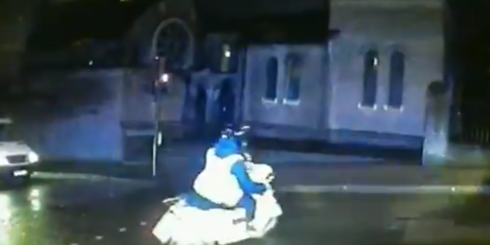 Met police officers pursue a moped shortly before making an arrest