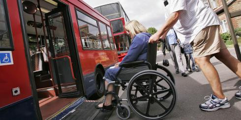 A wheelchair user accessing a bus
