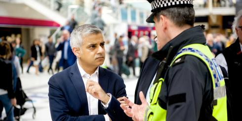 Mayor of London Sadiq Khan speaks with a police officer at Liverpool Street station
