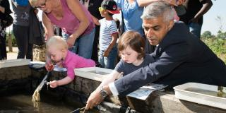 Mayor Sadiq Khan helps with pond dipping