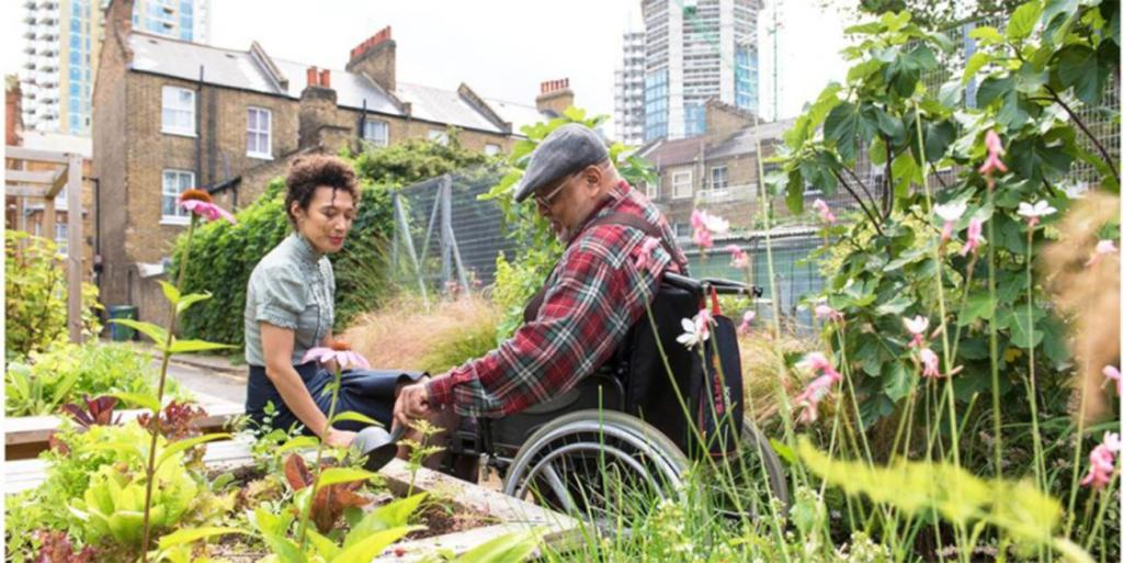 Two people gardening in a community space