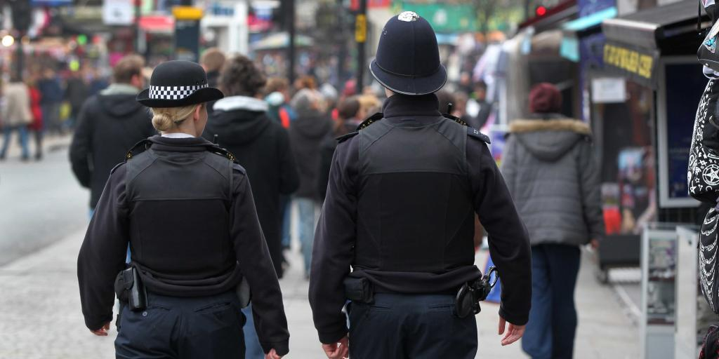 Two police constable patrol a high street
