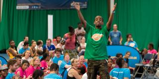 Young man cheering at a Disability Sports Coach festival