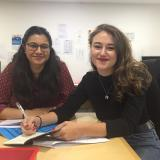 Volunteers Smriti and Laura in the BID office