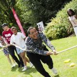 VI young people playing sport games in a park.