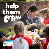 Rainbow leader with Rainbows planting flowers with 'help them grow' written.
